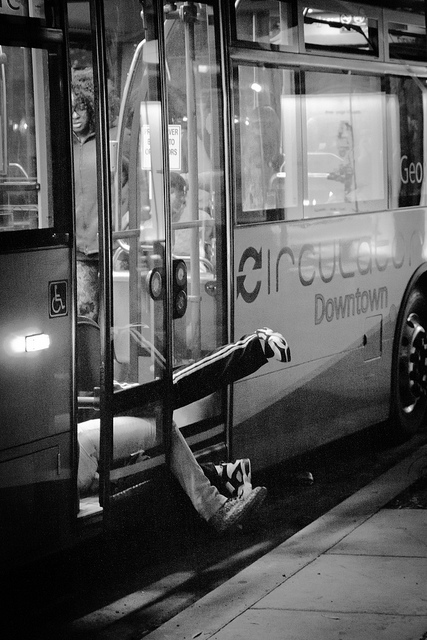 A couple jumps into the rear doors of the Circulator bus as the doors closes... they didn't quite make it.